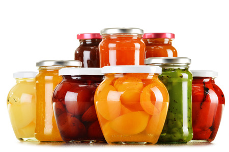 jam jar: Jars with fruity compotes and jams isolated on white background. Preserved fruits