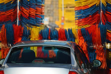 to wash: Car going through an automated car wash machine.