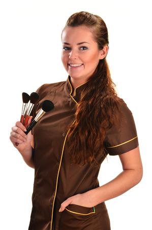 beautician: Professional beautician holding brushes