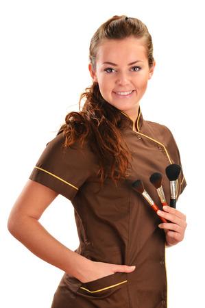 smock: Professional beautician holding brushes