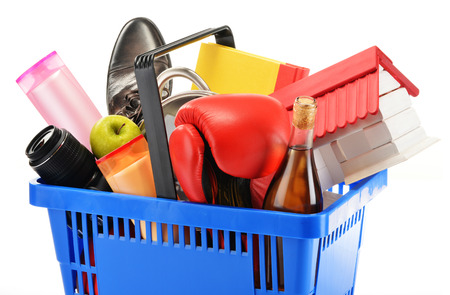 cleaning debt: Variety of consumer products in plastic shopping basket isolated on white Stock Photo