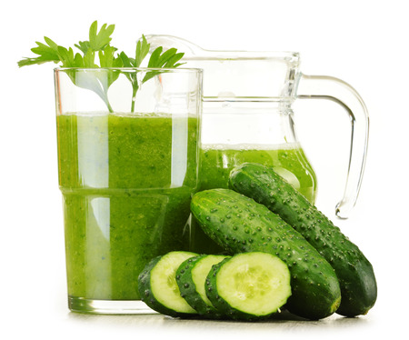 Glass with fresh vegetable juice isolated on white. Detox diet.