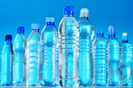 Composition with assorted plastic bottles of mineral water photo