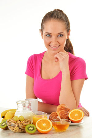balanced diet: Young woman having breakfast. Balanced diet