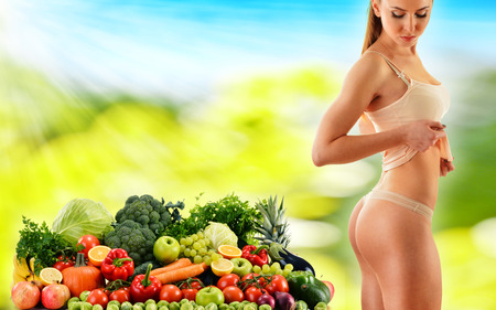 Dieting. Balanced diet based on raw organic vegetables and fruits photo