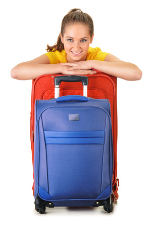 Young woman with travel suitcases. Tourist ready for a trip. photo