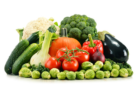 consuming: Composition with assorted raw organic vegetables isolated on white