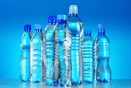 water bottle: Composition with assorted plastic bottles of mineral water
