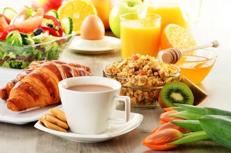 eating breakfast: Breakfast with coffee, juice, croissant, salad, muesli and egg. Swedish buffet