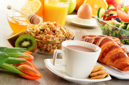 digesting: Breakfast with coffee, juice, croissant, salad, muesli and egg. Swedish buffet