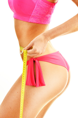 body curve: Sexy young woman measuring herself. Weight loss. Stock Photo
