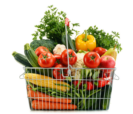 Wire shopping basket with groceries isolated on white background Stock fotó