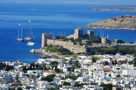 castle buildings: View of Bodrum harbor during hot summer day. Turkish Riviera.