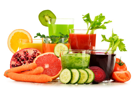 natural juices: Glasses with fresh organic vegetable and fruit juices isolated on white. Detox diet.