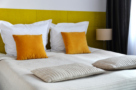 double bed: Double bed in hotel room. Accommodation