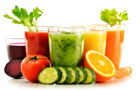 eating fruit: Glasses with fresh organic vegetable and fruit juices isolated on white. Detox diet.