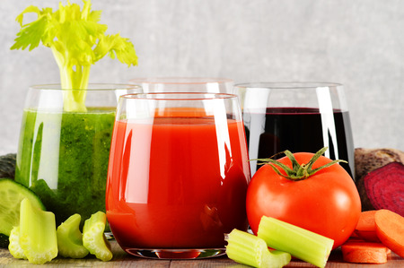 metabolism: Glasses with fresh organic vegetable juices on wooden table. Detox diet