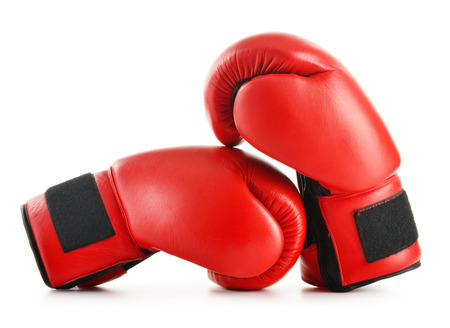 boxing gloves: Pair of red leather boxing gloves isolated on white