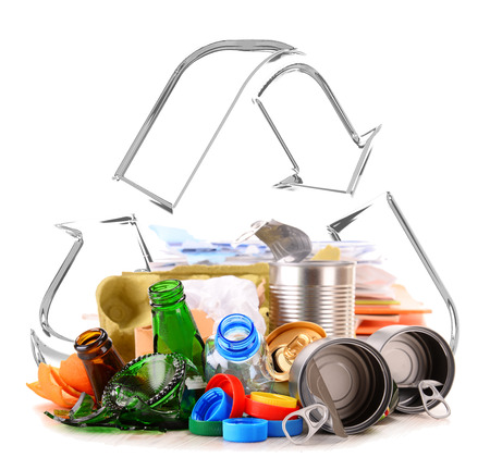 Composition with recyclable garbage consisting of glass, plastic, metal and paper isolated on white background