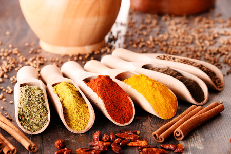 Variety of spices on kitchen table. Stockfoto