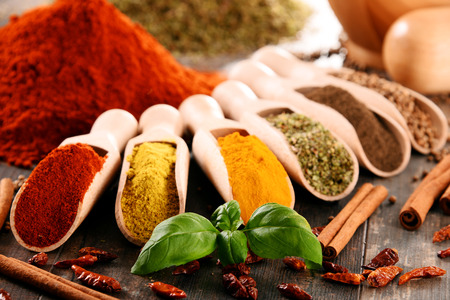 Variety of spices on kitchen table. Banco de Imagens