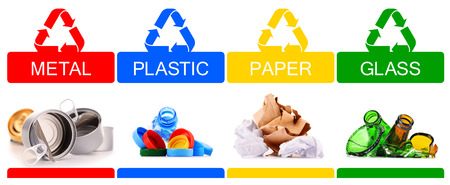 Recyclable garbage consisting of glass, plastic, metal and paper isolated on white background photo