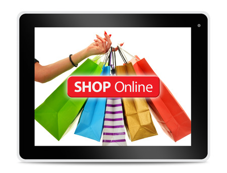 paper screens: Paper shopping bags on computer tablet screen. Shopping online. E-commerce Stock Photo