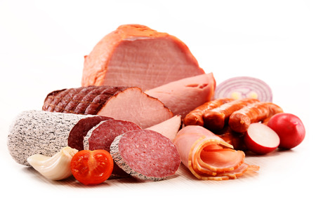 product: Assorted meat products including ham and sausages isolated on white Stock Photo