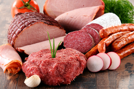 Assorted meat products including ham and sausages. Imagens
