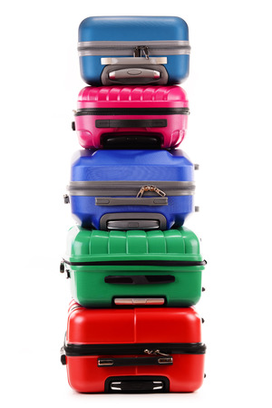 suitcase packing: Stack of plastic suitcases isolated on white background Stock Photo