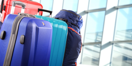 suitcase packing: Plastic travel suitcases in the airport hall.