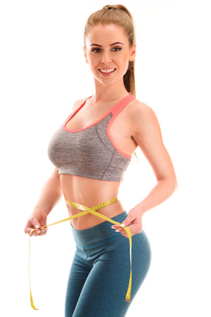 woman measuring: Young woman measuring herself Stock Photo