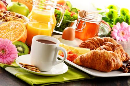 Breakfast consisting of fruits, orange juice, coffee, honey, bread and egg. Balanced diet. Stock Photo - 40377240