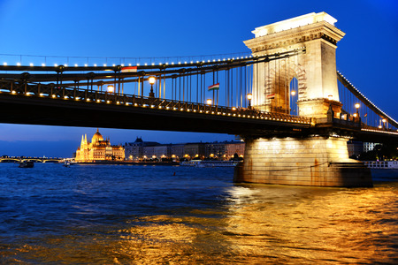 building a chain: Chain Bridge and Hungarian Parliament Building on the bank of the Danube in Budapest by night