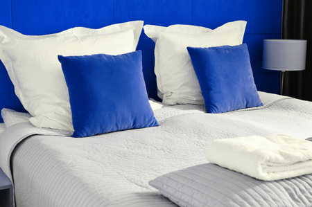 accommodation: Double bed in hotel room. Accommodation