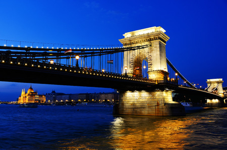 the chain bridge: Chain Bridge and Hungarian Parliament Building on the bank of the Danube in Budapest by night