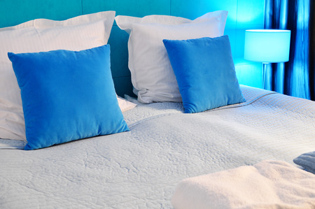 bed linen: Double bed in hotel room. Accommodation