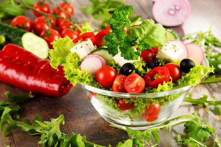 vegetable salad: Vegetable salad bowl on kitchen table Stock Photo