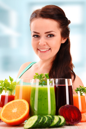 cleanse: Young woman with variety of vegetable and fruit juices. Detox diet.