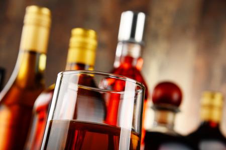 distilled alcohol: Bottles of assorted alcoholic beverages.