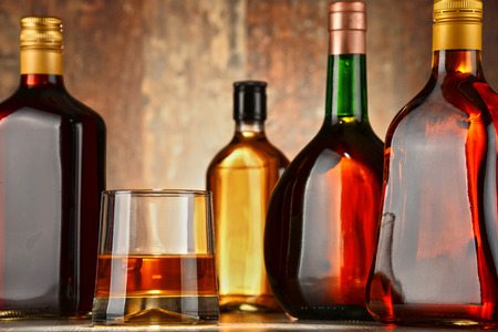 excise: Bottles of assorted alcoholic beverages.