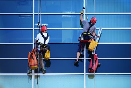 Two construction workers working at height