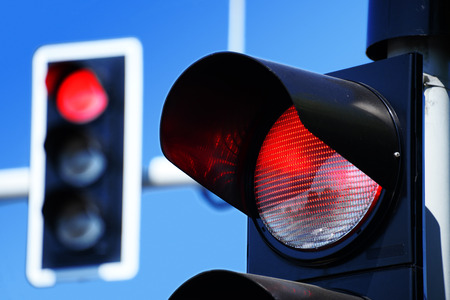 red sign: Traffic lights over blue sky Stock Photo