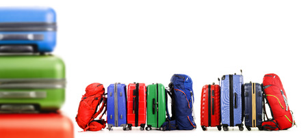 travel bag: Luggage consisting of large suitcases and backpacks isolated on white. Stock Photo