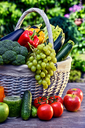balanced diet: Variety of fresh organic vegetables and fruits in the garden. Balanced diet Stock Photo