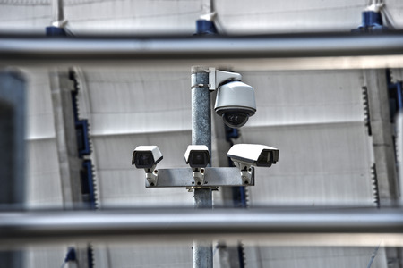 guarded: High tech overhead security camera system installed in guarded industrial area.