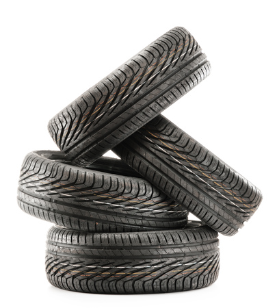 summer tire: Four new black tires isolated on white background Stock Photo