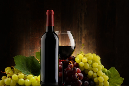 cabernet sauvignon: Composition with glass, bottle of red wine and fresh grapes Stock Photo