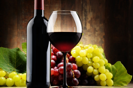 grapes: Composition with glass, bottle of red wine and fresh grapes Stock Photo