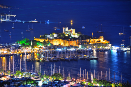 marina water: View of Bodrum harbor and Castle of St. Peter by night. Turkish Riviera.
